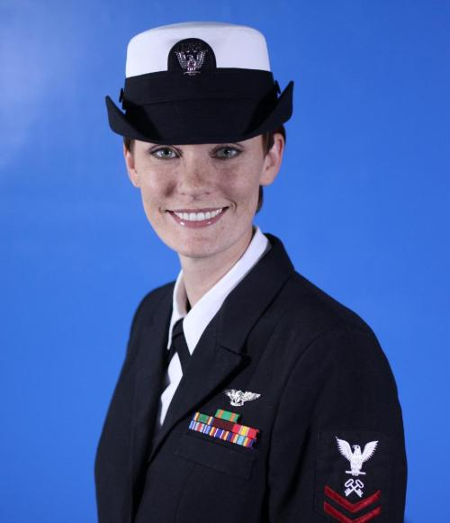 A woman in uniform... now it's my turn to form an orderly queue.