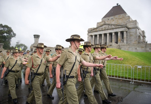 Soldiers march past the Shrine of Remembrance in Melbourne, Australia