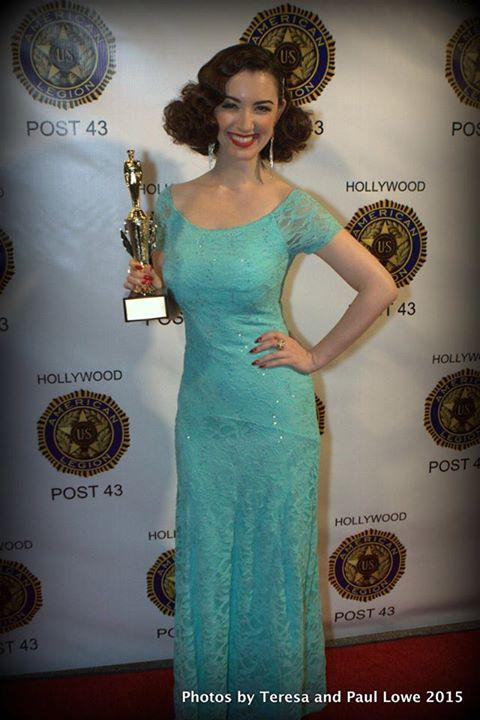 Gina with award