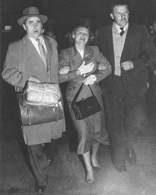 Evdokia Petrov being escorted to a waiting plane by diplomatic couriers1_416069_tcm11-17754