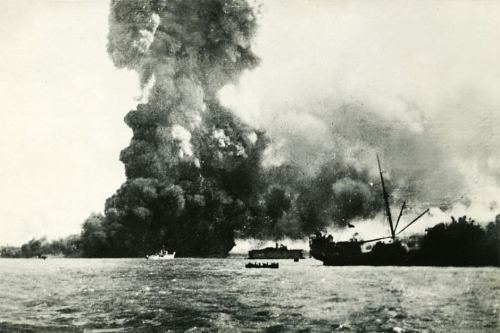 MV Neptuna was unloading artillery and explosives when the raiders struck. Cargo exploded as the sailors took to the boats.